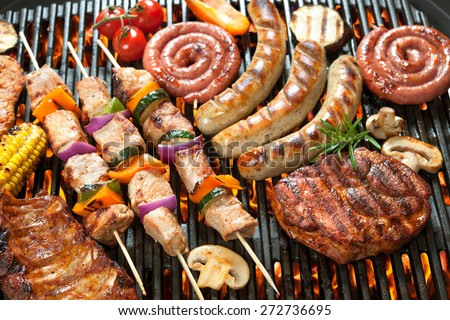 Assorted delicious grilled meat with vegetable over the coals on a barbecue - stock photo