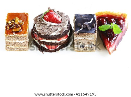 Assorted desserts, cakes and pastries on a white background - stock photo