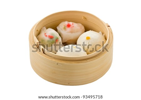 Assorted dim sum in bamboo steamer against a white background. - stock photo
