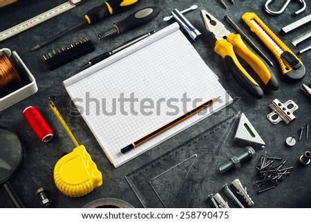 Assorted Do It Yourself DIY Tools and Blank Page Notebook as Copy Space for Home Improvement Project Planning or any Other Workshop Message. - stock photo