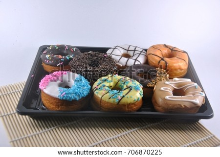 Assorted donuts isolated on white background.