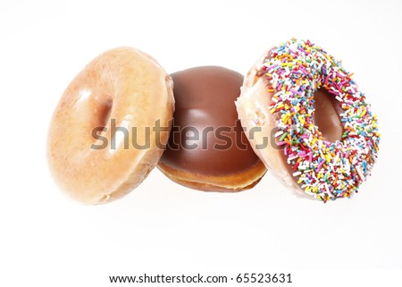 Assorted donuts on a white background. - stock photo