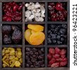 assorted dried fruit in a printers box, figs, cherries, raisins, strawberries, figs, cranberries, blueberries and apricots - stock photo