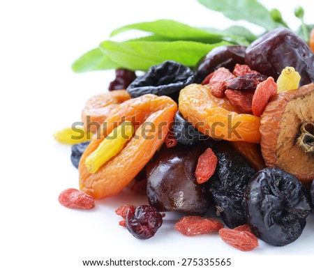 Assorted dried fruits (raisins, apricots, figs, prunes, goji, cranberries) on a white background - stock photo