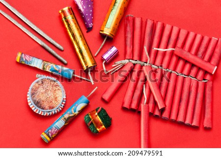 Assorted firecrackers for Diwali festival on red background  - stock photo