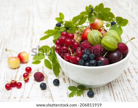 Assorted fresh berries on a wooden  background