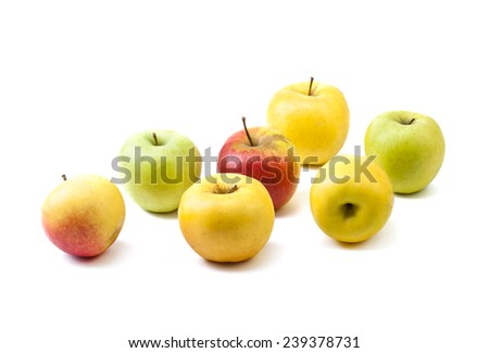 Assorted fresh ripe apples on white.