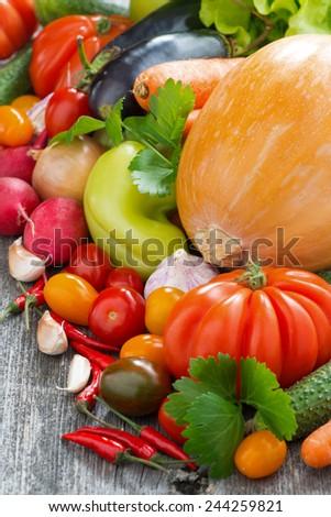Assorted fresh seasonal vegetables, vertical - stock photo