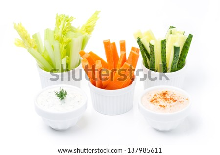 assorted fresh vegetables and two yogurt sauce isolated on a white background