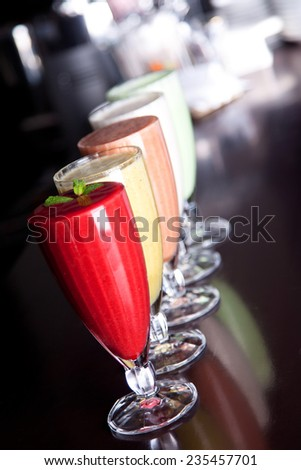 Assorted fruit and berry smoothies on the bar
