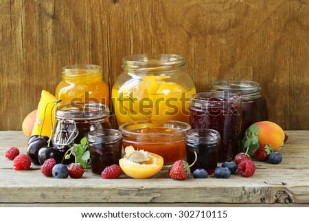 Assorted fruit berry jams (apricot, strawberry, raspberry, orange) - stock photo