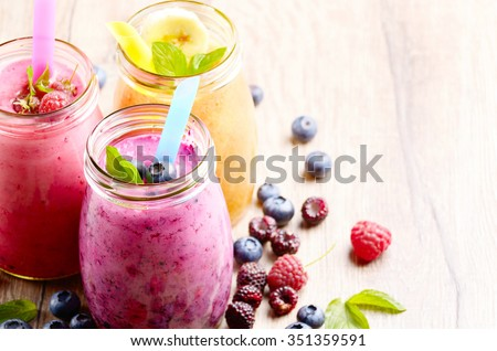Assorted fruit shakes on white table. Smoothie concept - stock photo