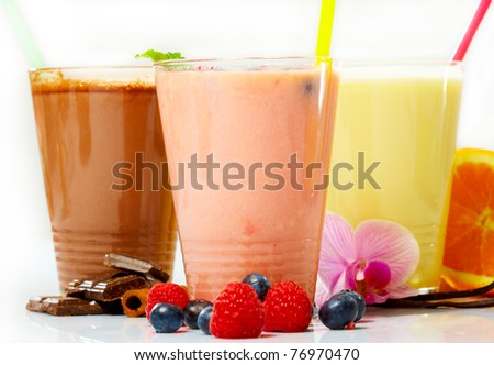 Assorted fruit smoothies close up on white background - stock photo