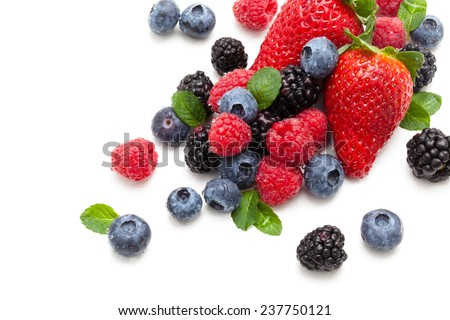 Assorted fruits and mint leaves with water drops. Isolated on white background. - stock photo