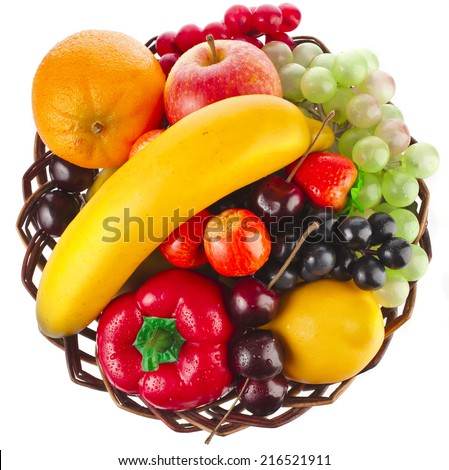 assorted fruits in wicker basket top view surface isolated on white - stock photo