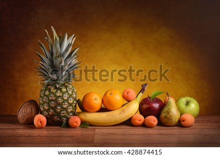 assorted fruits on the wooden table - stock photo