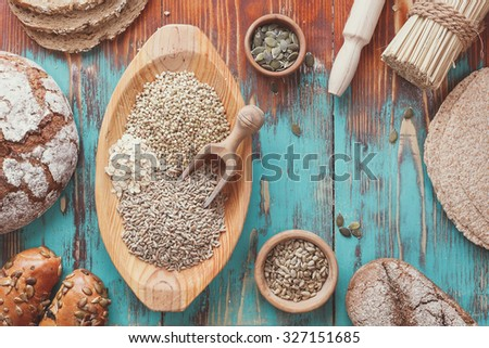 Assorted grains and bread. Preparing food concept, country  style . Bread full rich grains and natural ingredients.  Top view, vintage toned