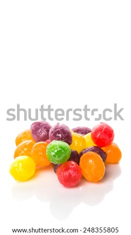 Assorted hard candy sweets over white background