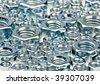 Assorted hex nuts background, selective focus - stock photo