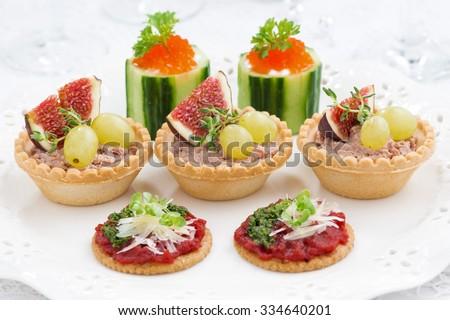 Assorted holiday mini appetizers, closeup, horizontal - stock photo