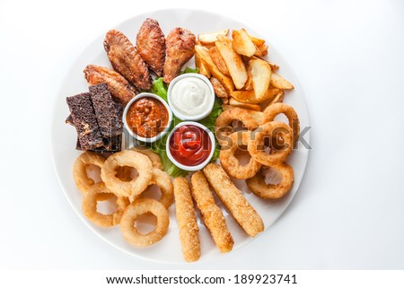 Assorted hot snacks. roasted cheese, croutons, onion rings with ketchup - stock photo