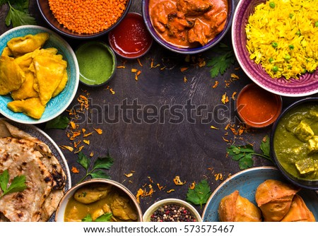Assorted indian food on dark wooden stock photo 573575467 for 7 spice indian cuisine