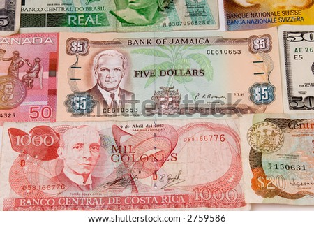 assorted international paper money close up - stock photo