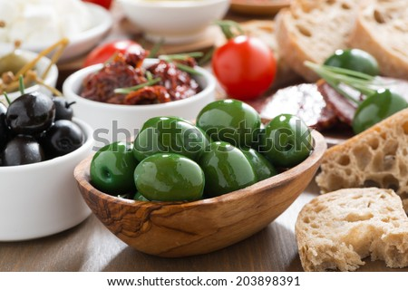 assorted Italian antipasti - olives, pickles and bread, close-up - stock photo