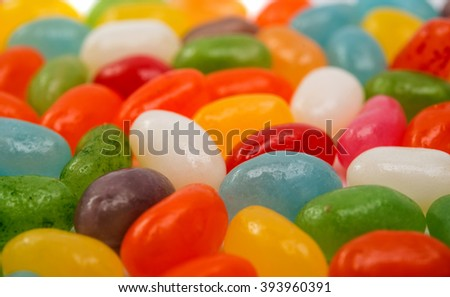 Assorted jelly beans on white bakground - stock photo