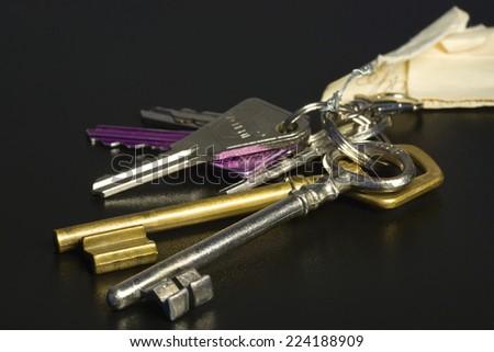 Assorted keys on key ring, close-up - stock photo