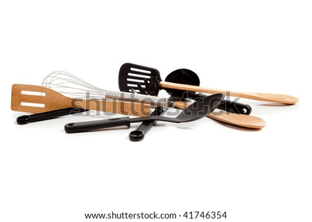 Assorted kitchen utensils including spatula, wooden spoon, egg turner, whisk, pasta ladle and slotted spoon