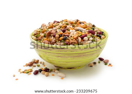 Assorted legumes in a bowl. Isolated on white background. - stock photo