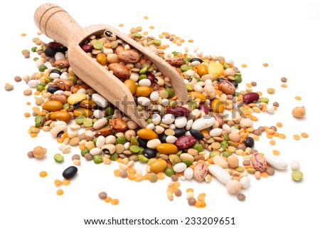 Assorted legumes in wooden scoop. Isolated on white background. - stock photo