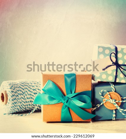 Assorted light blue handmade present boxes with twine - stock photo