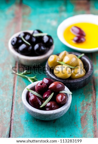 Assorted marinated olives in small bowls - stock photo