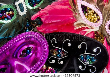 Assorted masks on beads - stock photo