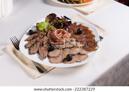 Assorted Meats on Plate at Restaurant Place Setting - stock photo