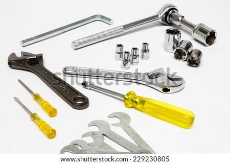 Assorted mechanical hand-tolls isolated on white background