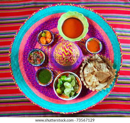 assorted Mexican sauces spices chili pico gallo on Mexican colorful hat