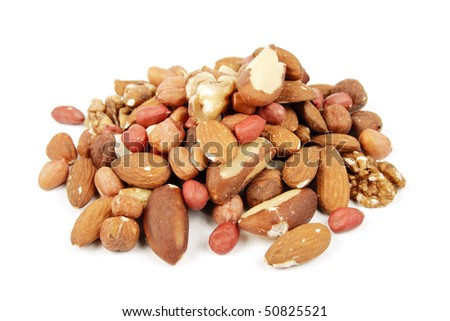 Assorted mixed nuts on a reflective white background