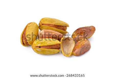 Assorted mixed nuts on white background - stock photo