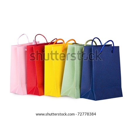 Assorted multi-color shopping bags on a white background - stock photo
