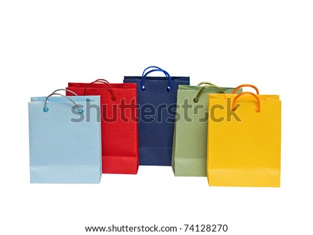 Assorted multi-color shopping bags on a white background