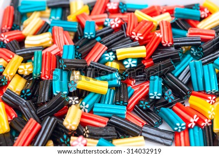 Assorted multicolored gummy chewy candies with various flavors. Children favorite treat - stock photo