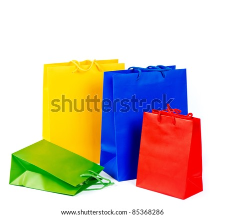 assorted multicolored shopping bags. sale concept. red, blue, yellow, green.