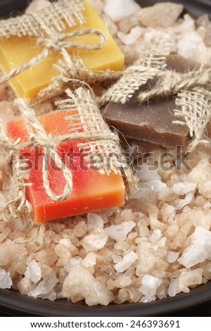 Assorted natural soaps and bath salt close-up. - stock photo