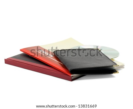 assorted notebooks and cd isolated on white background - stock photo
