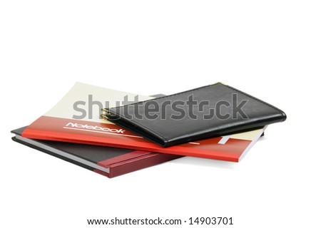 assorted notebooks flat piled on white background - stock photo
