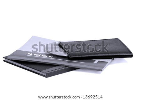 assorted notebooks with a cd flat piled on white background,blue filter - stock photo