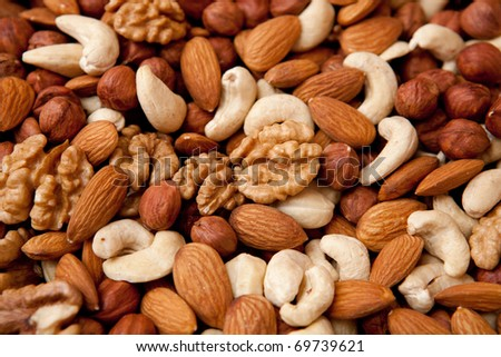 Assorted nuts (almonds, filberts, walnuts, cashews), close-up - stock photo